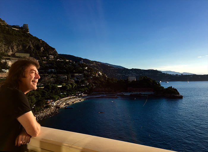 Steve looking out over the Mediterranean from a balcony in Monaco