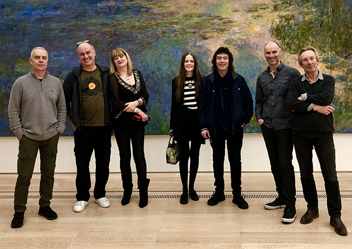 Roger, Ben, Les, Jo, Steve, Rob and Brian in front of a Monet painting in the gallery