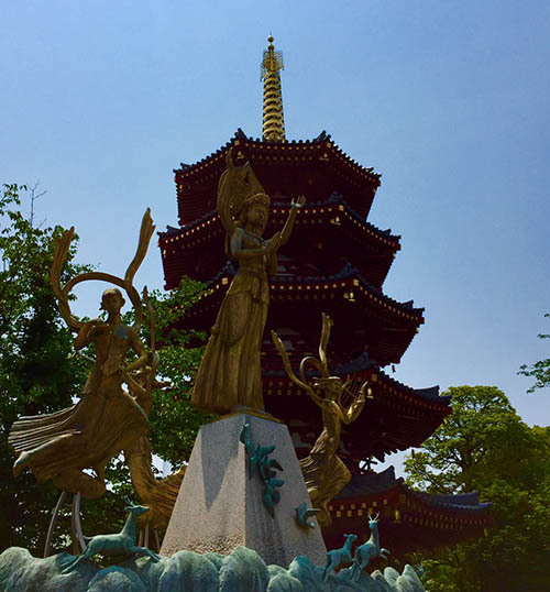Pagoda and golden statues in the temple complex
