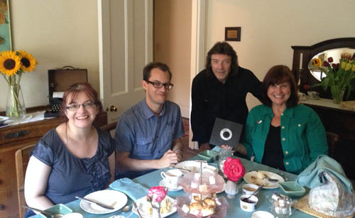 Tracey, Paul, Steve and Debbie enjoying cream tea in the Kilns dining room. Debbie is holding an old single of Steve's Narnia song.